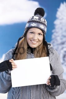 Young female front of winter landscape smiling