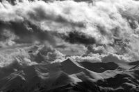 Black and white evening mountains and cloudy sky