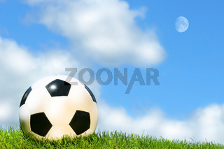 Soccerball against a blue sky