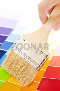 Hand holding paintbrush
