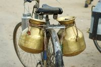 Copper milkpots on a bicycle, Ajmer, India