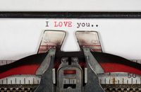 Macro detail of I Love You on electric typewriter with ribbon