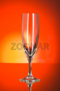 Wine glasses against colourful background