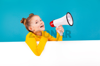 cute little girl in yellow pullover with the speaker