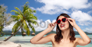 woman with sunglasses over tropical beach