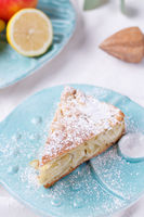 apple pie on a blue plate. lemon with apples