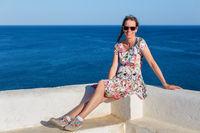 Dutch woman as tourist with blue sea