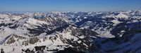 Saanenland valley on a winter morning. view from Glacier des Diablerets, Switzerland.