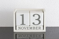 White block calendar present date 13 and month November