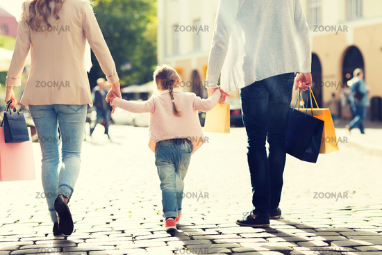 close up of family with child shopping in city