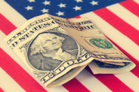 USA flag with one dollar banknote