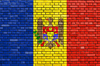 flag of Moldova painted on brick wall