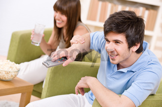 Student - happy teenagers watching television