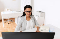 businesswoman with computer working at office