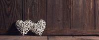 Wicker hearts on wood