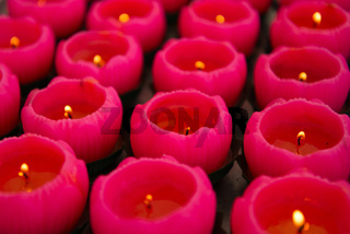Red candles with lotus form in chinese temple