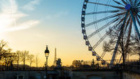 The ferris wheel and the Eiffel Tower in Paris