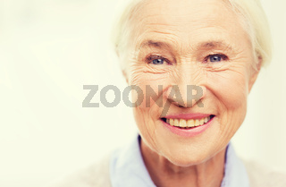happy senior woman face at home