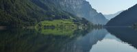Summer scene at lake Klontalersee, Glarus Canton. Swiss Alps. Reflection.