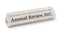 Rolled newspaper with the headline Annual review 2017