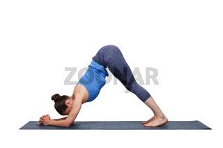 Woman doing Hatha yoga asana Ardha Pincha Mayurasana