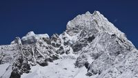 Snow covered peaks of Kangtega and Thamseku. High mountains in the Mount Everest National Park, Nepal.