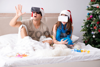Happy couple celebrating christmas holiday in bed