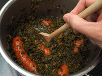 Cooked kale with smoked sausages