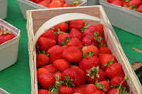 Close up strawberry in wooden crate on market