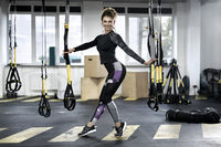 Sportive girl in gym