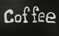 White chalk COFFEE word over black chalkboard