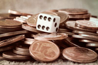 Dice and coin pile