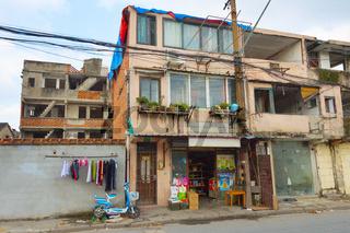 Building  Shanghai slum area. China