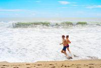 Couple jogging on th beach