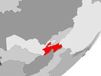 Tajikistan in red on grey map