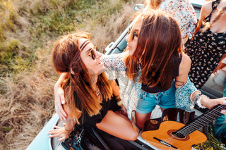 Girls in a cabriolet posing on the camera