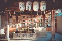 Kazaridaru barrels in Maruyama garden, Kyoto, Japan