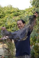 Fischer mit Beute