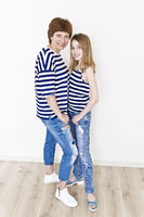 Beautiful mother and daughter in striped clothes