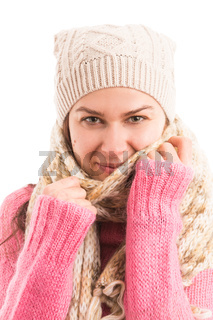 Young female model wearing warm knitted scarf and hat