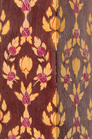Column with floral painting in red and yellow colors