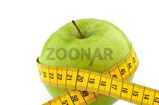 Apfel mit Massband. Symbol für Diät mit Obst.