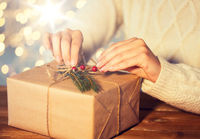 close up of woman with christmas gift or parcel