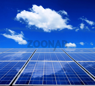 Solar energy panel with blue sky and clouds