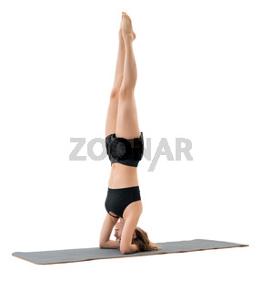 Woman doing headstand in studio isolated shot