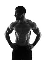 Silhouette of a bodybuilder on a white background