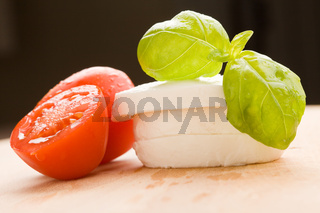 Tomatoe and Mozzarella on Cutting board