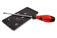 Smartphone with broken screen and screwdriver isolated on a white background