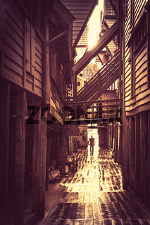 Retro vintage image of a historic wooden buildings in Bryggen