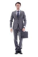 Businessman handing briefcase